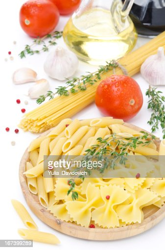 different kinds of Italian pasta, tomatoes and spices : Stock Photo