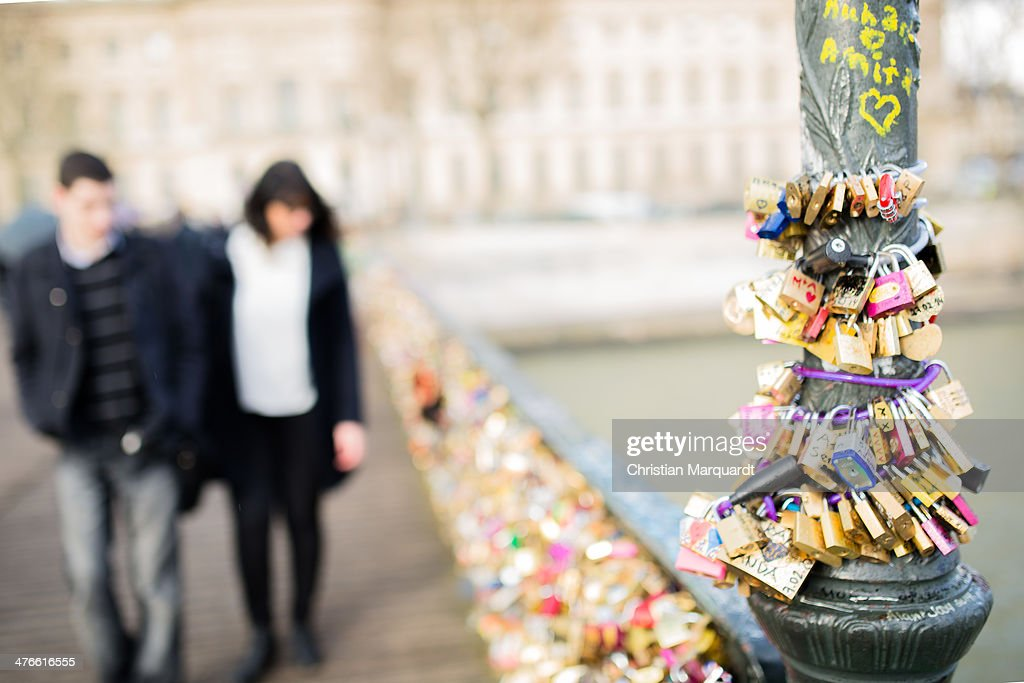 Different kinds of locks are pictured at the Bridge of Arts (Pont des Arts) during a rainy day on February 28, 2014 in Paris, France. Couples attach locks as a sign of their love to the railing of the bridge.