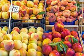 Different kinds of peaches for sale at a market in Palermo, Sicily