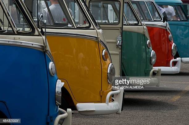 Different models of Kombis are exhibited at the Volkswagen plant in Sao Bernardo do Campo southern Sao Paulo Brazil on December 8 2013 VW's Kombi or...