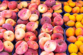Different peaches for sale at a market in Palermo, Sicily