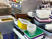 Different plastic containers in the food factory