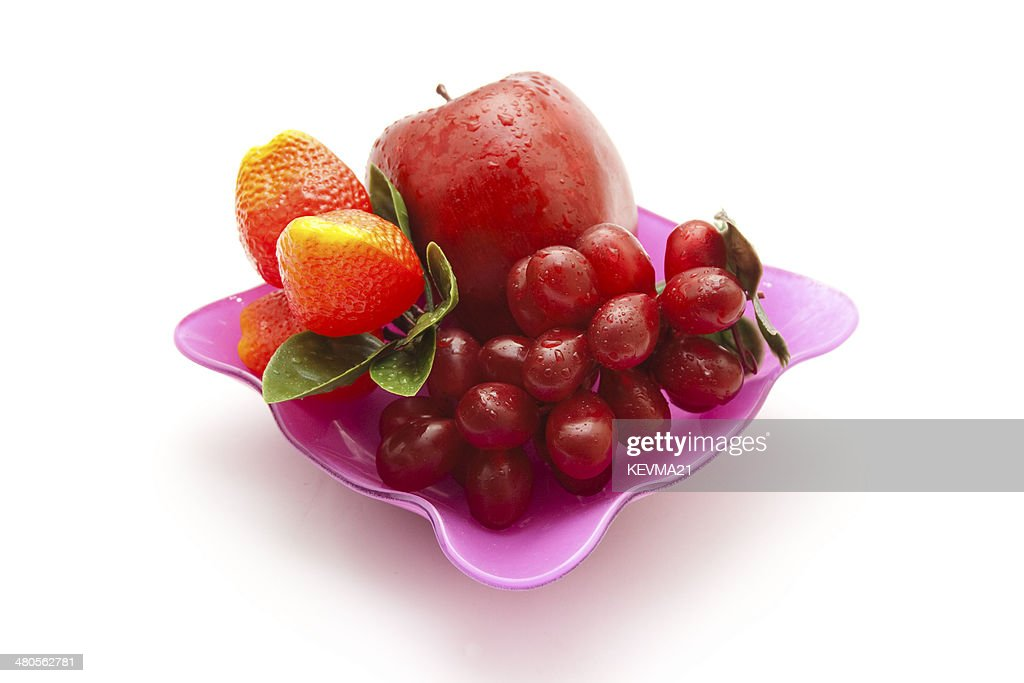 Different Plastic Fruits in Glass Bowl : Stock Photo