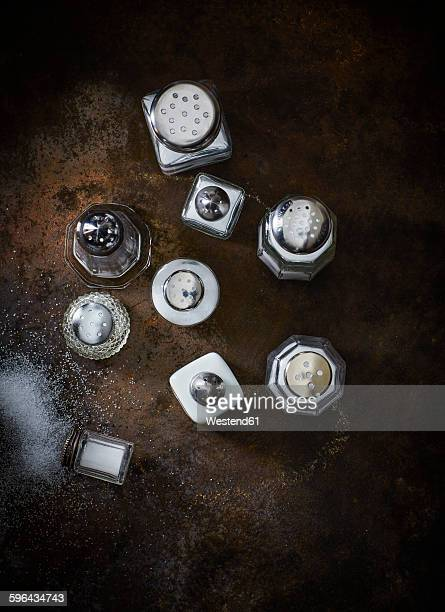 Different salt shakers on rusty metal
