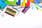 Different school supplies on white background with copy space, top view