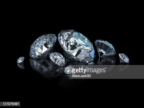 Different sized, cut and polished diamonds isolated on black : Stock Photo
