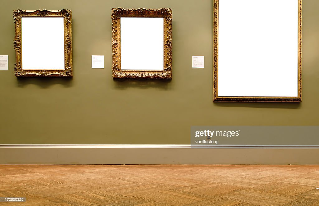 Different sized empty frames on the wall