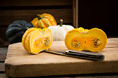 Different sorts of mini squashes with sliced Jack be Little in the foreground