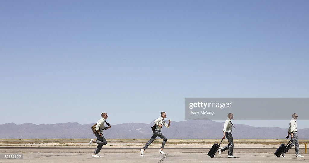 different staging of man walking to running : Stock Photo