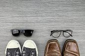 Different Style of men fashion, Compare of formal and casual fashion style, Sneakers, Leather Shoes, Sunglasses, Nerd Glasses. (Color Process)