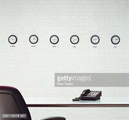 Different time zone clocks on wall in office : Bildbanksbilder