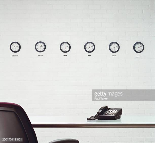 Different time zone clocks on wall in office