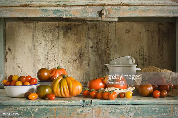 Different tomatoes on kitchen cabinet