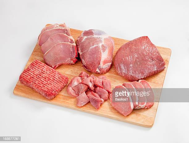 Different type of raw meat on a chopping board