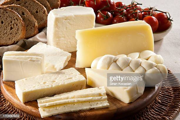 Different types of cheese, bread and tomatoes