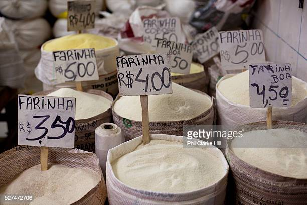 Different types of Farinha Farofa Manioc flour in market mercado Sao Jaoquim Salvador Bahia Brazil