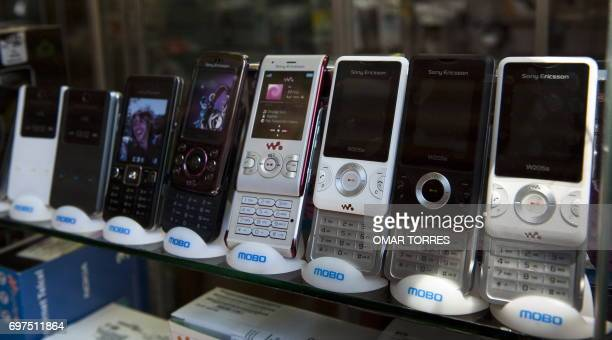 Different types of mobile phones are offered at one of the celular phone markets in Mexico City on May 10 2010 AFP PHOTO/OMAR TORRES / AFP PHOTO /...
