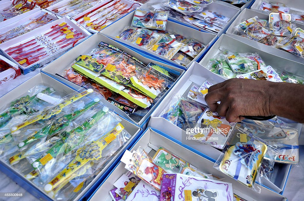 Different types of Rakhis on sale ahead of Raksha Bandhan on August 7, 2014 in Ghaziabad, India. The festival of Raksha Bandhan' or 'Rakhi' celebrate the brother-sister love. Sisters tie sacred Rakhi string on their brothers' right wrists and pray for their protection.