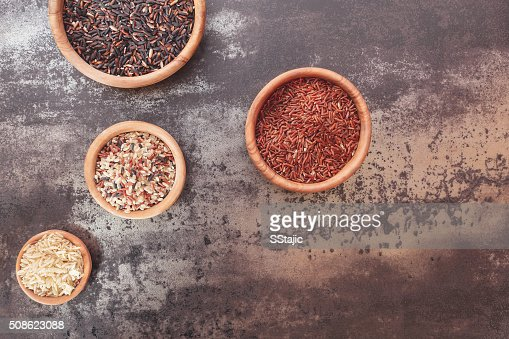 Different types of rice in small bowls : Stock Photo