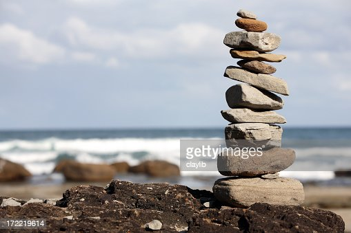Different types of rocks stacked on the beach
