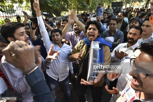 Different university students shout slogans During the citizens protest march for Justice and Save Delhi University end to Gundagardi Mandi house to...