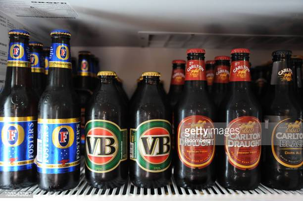 Different varieties of Foster's beer are stacked in a refrigerator at Foster's Group Ltd's Carlton United Breweries visitors centre bar in...