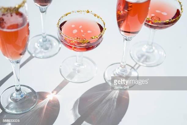Different wine glasses on white
