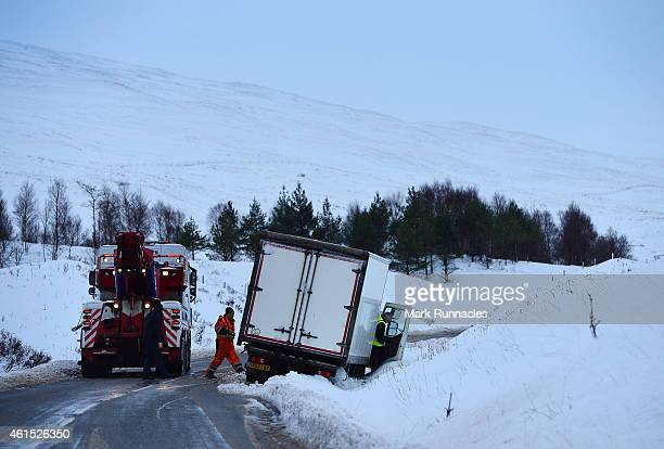 Difficult driving conditions as a lorry slides on the A82 as snow continues to fall on January 14 2015 in Tyndrum Scotland The Met Office has issued...