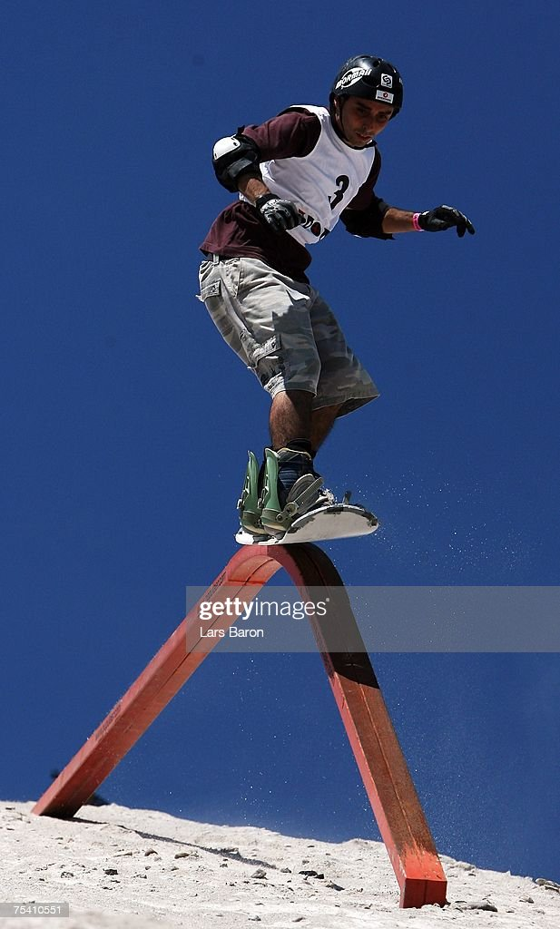 Digacomo Diaz of Brazil slides over a rail during the Sandslopestyle competition at the Sandboarding World Championship 2007 at the Monte Kaolino on July 14, 2007 in Hirschau, Germany.