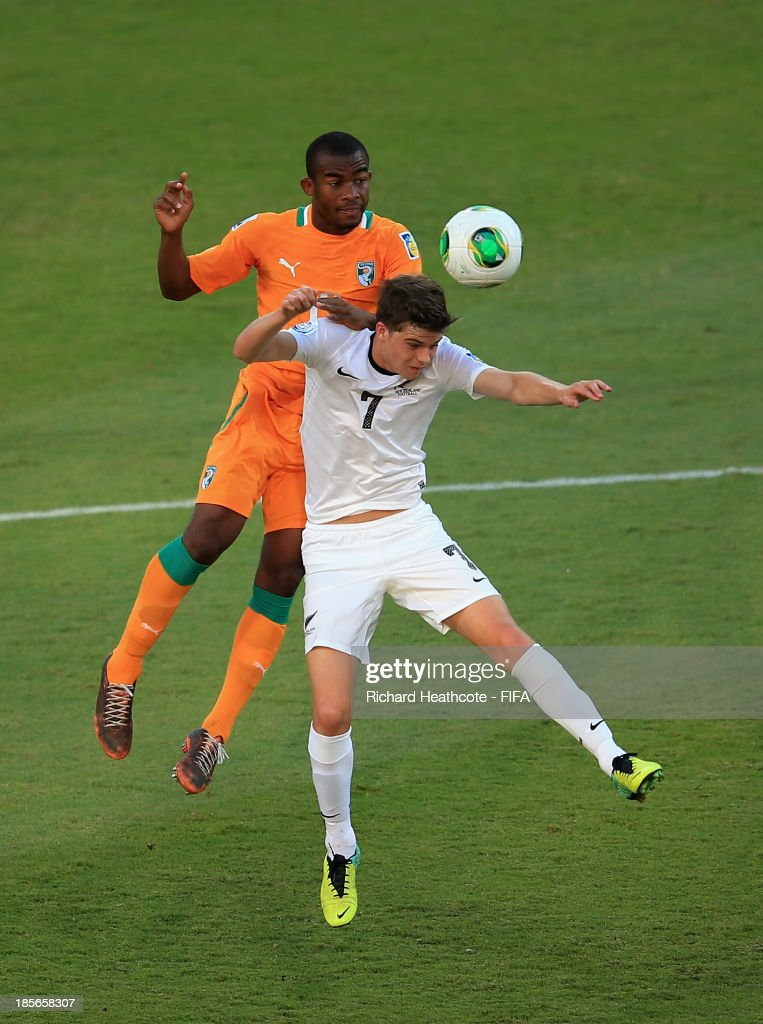 Digbo Maiga of Ivory Coast battles with Alex Rufer of New Zealand during the FIFA U-17 World Cup UAE 2013 Group B match between New Zealand and Ivory Coast at the Mohamed Bin Zayed Stadium on October 23, 2013 in Abu Dhabi, United Arab Emirates.