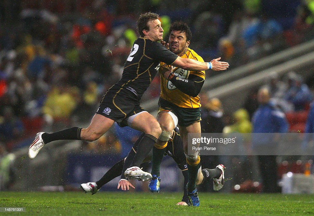<a gi-track='captionPersonalityLinkClicked' href=/galleries/search?phrase=Digby+Ioane&family=editorial&specificpeople=636564 ng-click='$event.stopPropagation()'>Digby Ioane</a> of Australia is tackled by Matthew Scott of Scotland during the International Test match between the Australian Wallabies and Scotland at Hunter Stadium on June 5, 2012 in Newcastle, Australia.