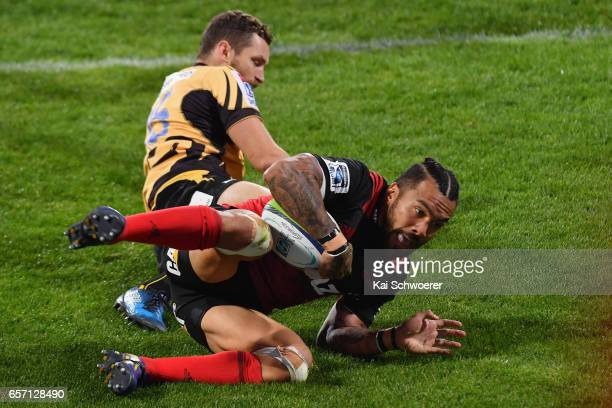 Digby Ioane of the Crusaders dives over to score a try during the round five Super Rugby match between the Crusaders and the Force at AMI Stadium on...