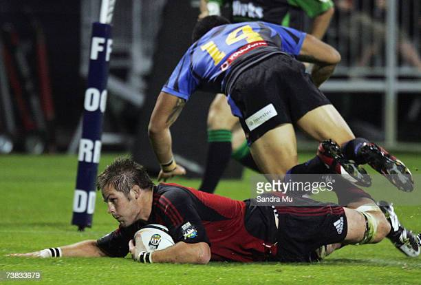 Digby Ioane of the Force falls over Richie McCaw of the Crusaders as he scores a try during the Super 14 round ten match between the Crusaders and...