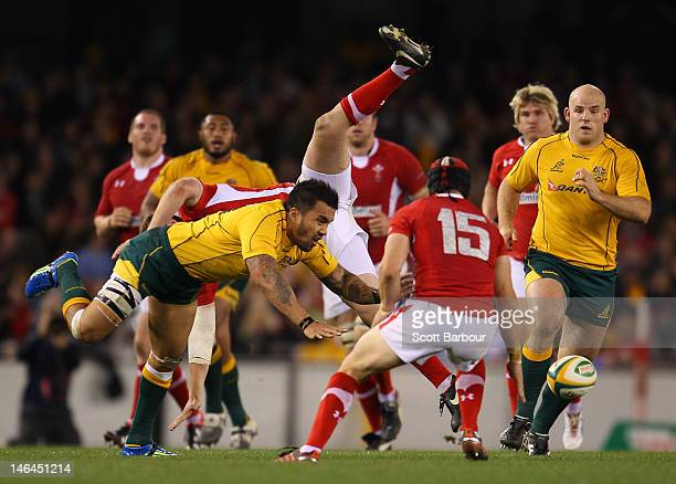 Digby Ioane of the Wallabies competes for the ball with Rhys Priestland of Wales during the International Test Match between the Australian Wallabies...