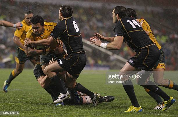 Digby Ioane of the Wallabies is tackled during the International Test match between the Australian Wallabies and Scotland at Hunter Stadium on June 5...
