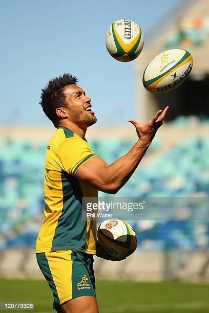 Digby Ioane of the Wallabies juggles rugby balls during an Australian Wallabies training session at the Moses Mabhida Stadium on August 10 2011 in...