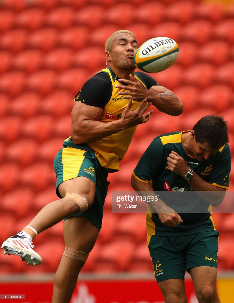 <a gi-track='captionPersonalityLinkClicked' href=/galleries/search?phrase=Digby+Ioane&family=editorial&specificpeople=636564 ng-click='$event.stopPropagation()'>Digby Ioane</a> of the Wallabies practices his skills alongside coach <a gi-track='captionPersonalityLinkClicked' href=/galleries/search?phrase=Robbie+Deans&family=editorial&specificpeople=606884 ng-click='$event.stopPropagation()'>Robbie Deans</a> during the Australian Wallabies Captain's Run at Suncorp Stadium on August 26, 2011 in Brisbane, Australia.