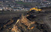 A digger at the the FfosYFran opencast coal mine moves materials on November 17 2009 in Merthyr Tydfil Wales As world leaders prepare to gather for...
