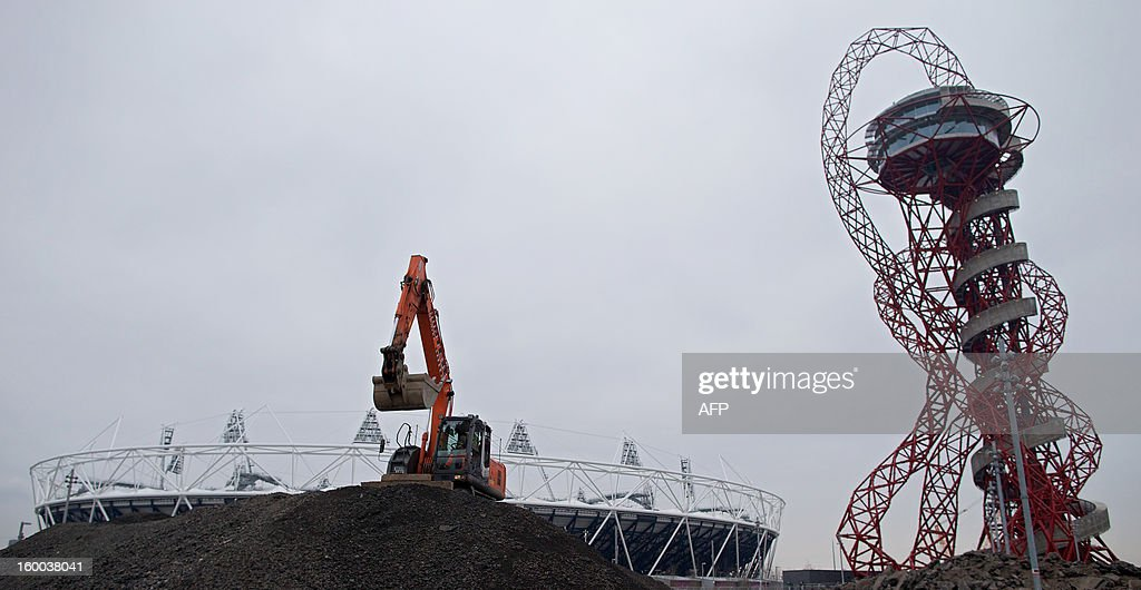 A digger (C) is pictured in front of the 2012 Olympic Stadium in east London, on January 25, 2013. Although the Olympic Stadium is due to stage the 2017 World Athletics Championships, doubt remains over its long-term future. The £292 million ($463 million, 348 million euro) complete transformation of the Olympic Park, which began when the London 2012 Games ended, is set to take 18 months.