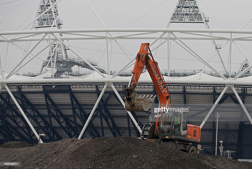 A digger is pictured in front of the former London 2012 Olympic Stadium in east London, on January 25, 2013. Although the Olympic Stadium is due to stage the 2017 World Athletics Championships, doubt remains over its long-term future. The £292 million ($463 million, 348 million euro) complete transformation of the Olympic Park, which began when the London 2012 Games ended, is set to take 18 months.