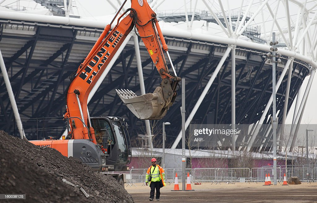 A digger is pictured in front of the London 2012 Olympic Stadium in east London, on January 25, 2013. Although the Olympic Stadium is due to stage the 2017 World Athletics Championships, doubt remains over its long-term future. The £292 million ($463 million, 348 million euro) complete transformation of the Olympic Park, which began when the London 2012 Games ended, is set to take 18 months.