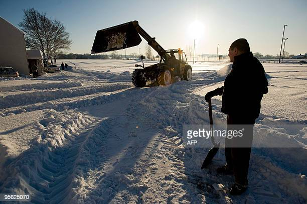 A digger is used to clear away heavy snow in St Boswells in Scotland on January 7 2010 Britain's harshest winter for decades continued to disrupt...