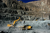 A digger loads a truck with diamond bearing rock ore also known as kimberlite in the satellite open pit at the Letseng diamond mine operated by Gem...
