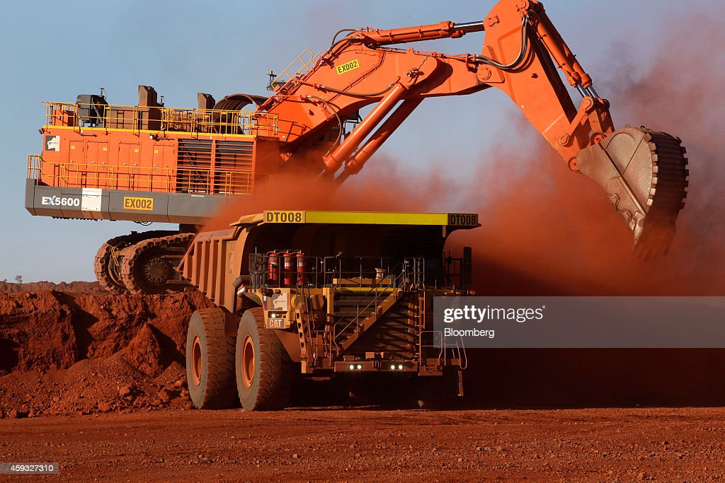 A digger loads ore onto a dump truck at the Delta 2 mine pit at Hancock Prospecting Pty's Roy Hill Mine operations under construction in the Pilbara...