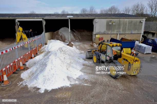 A digger moves a new delivery of salt at the Stroudwater council gritting depot in Gloucester