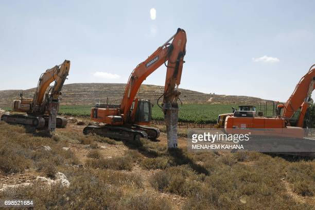 Diggers are seen as workers clear the land for the new Amichai settlement near the Shilo settlement between Ramallah and Nablus in the...