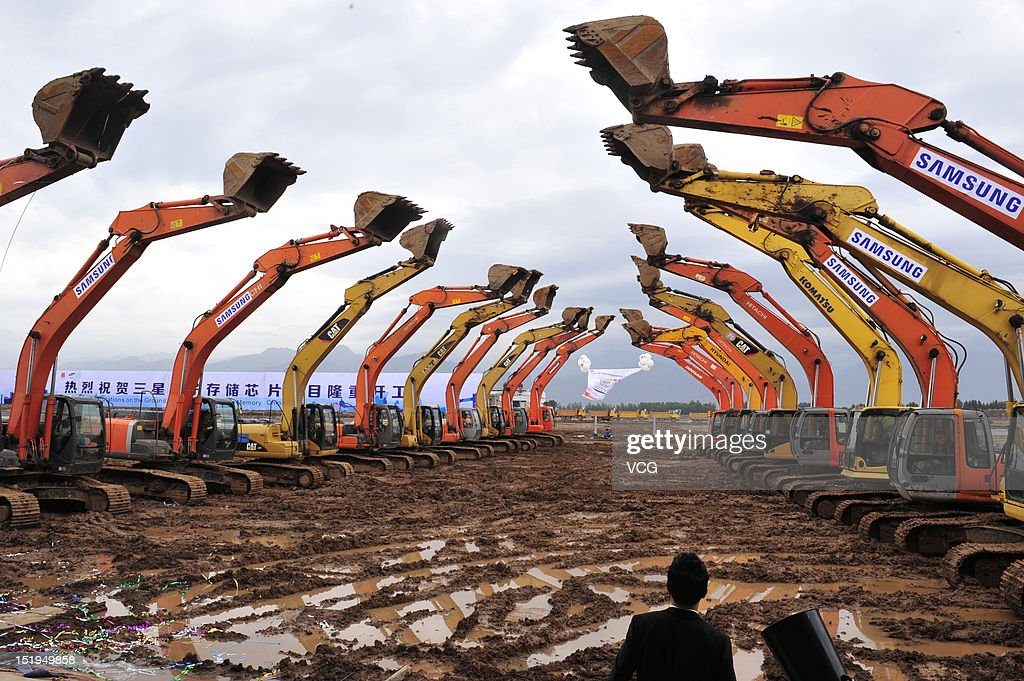 Diggers are seen during the Samsung China Semiconductor's groundbreaking ceremony for a new advanced memory fabrication line at Xi'an Hi-Tech Industrial Development Zone on September 12, 2012 in Xi An, China. Samsung Electronics Co. Ltd started construction on its new memory chip plant Wednesday, with first phase investment of 7 billion U.S. dollars.