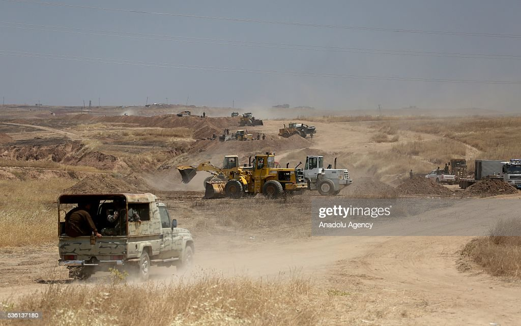 Diggers excavate ditches after Peshmerga forces recaptured nine villages from Daesh at Hazir region of Mosul in Nineveh, Iraq on May 30, 2016.