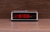 Digital alarm clock on wooden surface