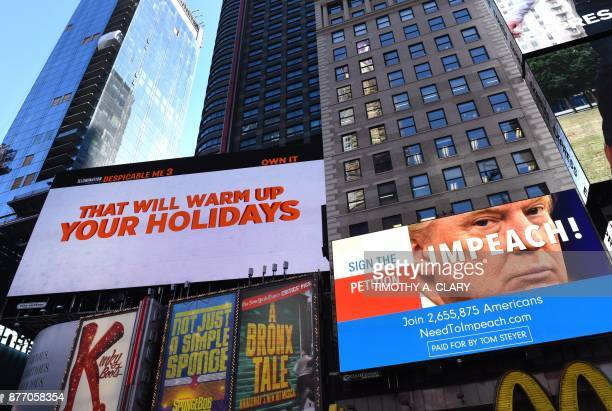 TOPSHOT A digital billboard appears in Times Square on November 21 2017 in New York funded by Tom Steyer the billionaire environmentalist and...
